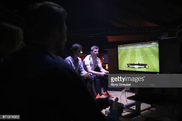Fans play a Playstation video game at the presentation of the 2018 FIFA World Cup Russia Adidas jersey at The Base on November 7 2017 in Berlin...