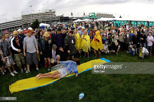 Fans play on a slip and slide as they party in the infield during the 137th Kentucky Derby at Churchill Downs on May 7 2011 in Louisville Kentucky