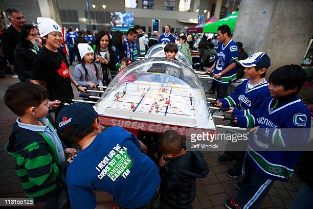 Fans play table hockey before the start of Game Five of the Western Conference Quarterfinals during the 2011 NHL Stanley Cup Finals against the...