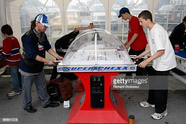 Fans play table hockey in the Fan Fest prior to Game Three of the Eastern Conference Semifinals between the Pittsburgh Penguins and Montreal...