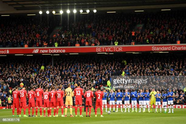 Fans players and officals observe a minutes silence for exLiverpool player Ronnie Moran who passsed away last week prior to the Premier League match...