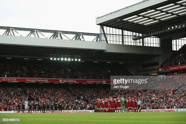 Fans players and officals take part in a minute of applause for the victims of the Barcelona terror attack prior to the Premier League match between...