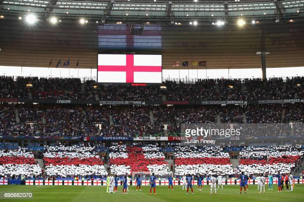 Fans players and officials observe a minute of silence for the victims of the recent terror attacks in the UK prior to the International Friendly...