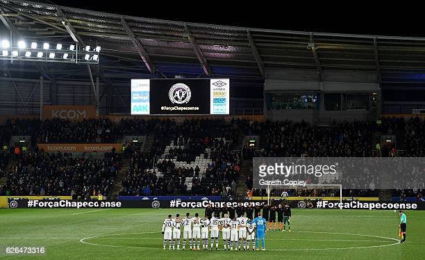 Fans players and officials observe a minutes silence for the victims of the plane crash involving the Brazilian club Chapecoense prior to the EFL Cup...