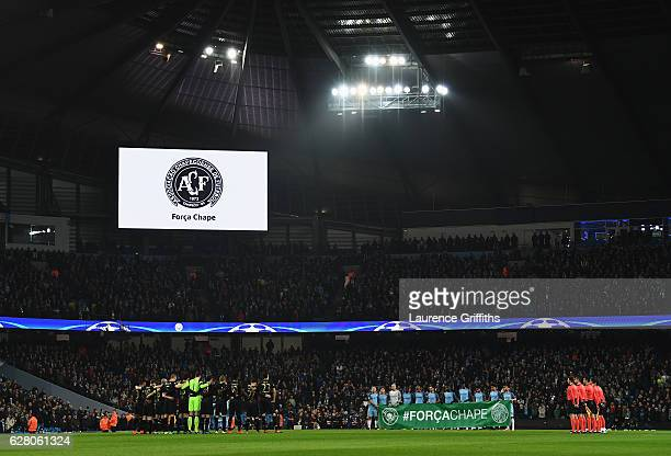 Fans, players and officials observe a minutes silence for the victims of the plane crash involving the Brazilian club Chapecoense prior to kick off...