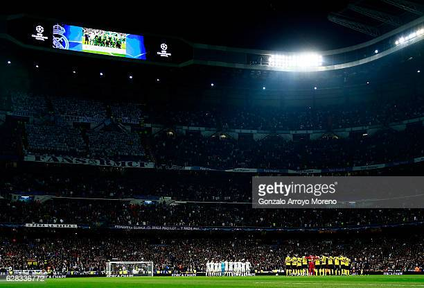 Fans players and officials observe a minutes silence for the victims of the plane crash involving the Brazilian club Chapecoense prior to kick off...