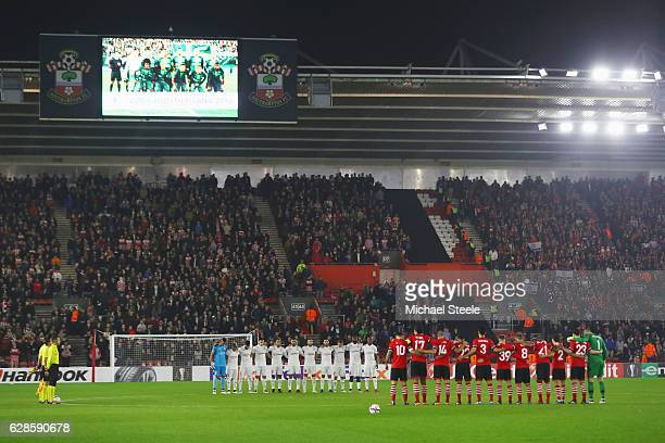 Fans players and officials observe a minutes silence for the victims of the plane crash involving the Brazilian club Chapecoense prior to the UEFA...