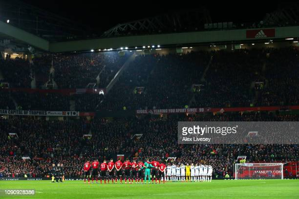 Fans players and officlas take part in a minute of silence in tribute to Emiliano Sala prior to the Premier League match between Manchester United...