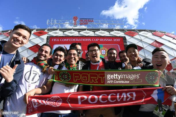 Fans pose ahead of the 2017 Confederations Cup group A football match between Russia and Portugal at the Spartak Stadium in Moscow on June 21 2017 /...