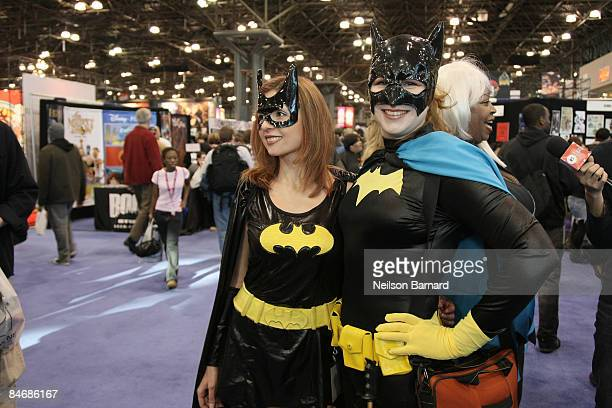 Fans pose as their favorite comic book and science fiction character 'Batgirl' at the 2009 New York Comic Con at the Jacob Javits Center on February...