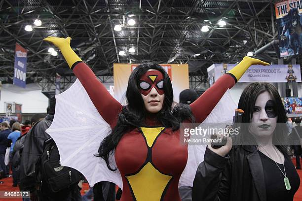 Fans pose as their favorite comic book and science fiction characters 'SpiderWoman' and 'Domino' at the 2009 New York Comic Con at the Jacob Javits...
