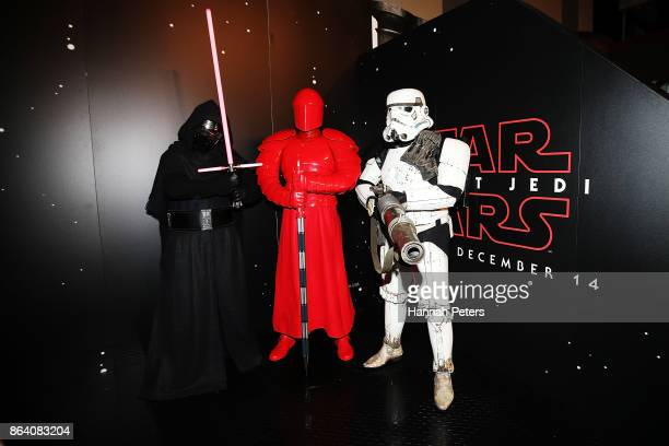 Fans pose at Star Wars The Last Jedi booth at Armageddon on October 21 2017 in Auckland New Zealand
