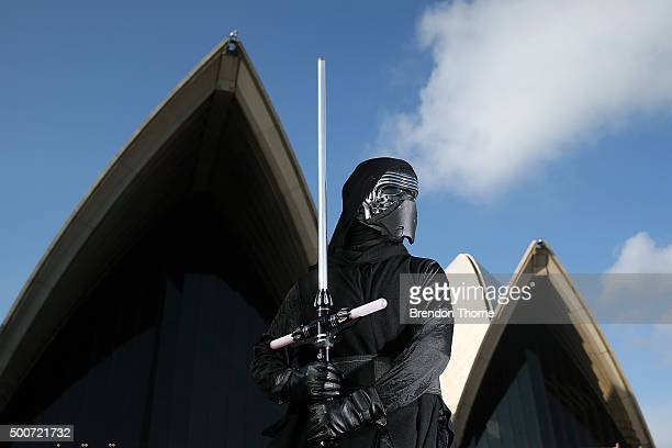 Fans pose at the Star Wars The Force Awakens fan event at Sydney Opera House on December 10 2015 in Sydney Australia