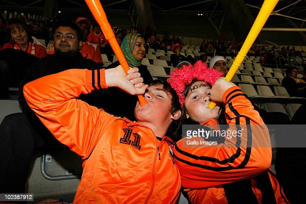 Fans pose during the 2010 FIFA World Cup South Africa Group E match between Cameroon and Netherlands at Cape Town Stadium on June 24 2010 in Cape...