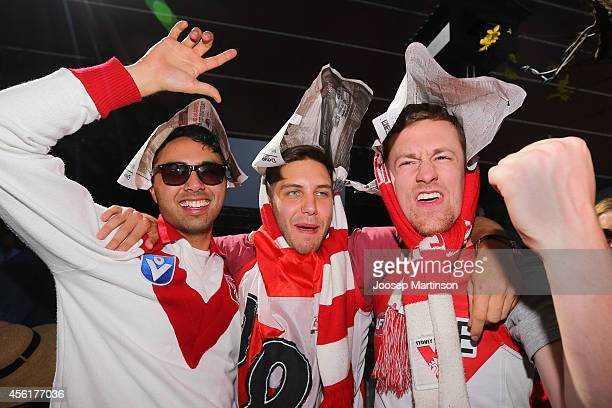 Fans pose during the 2014 AFL Grand Final at the MCG from the Sydney Swans Live Site at Sydney Cricket Ground on September 27 2014 in Sydney Australia
