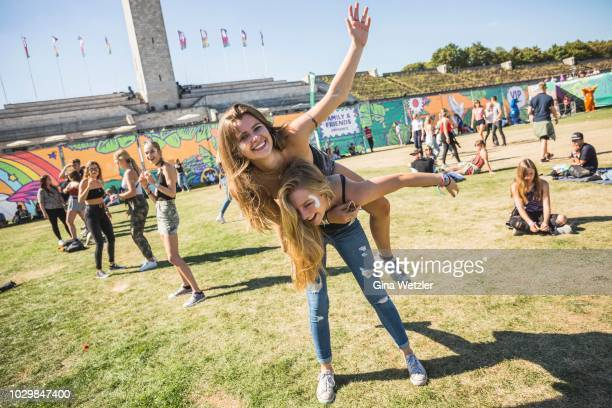 Fans pose during the Lollapalooza festival at the Olympiagelände on September 9, 2018 in Berlin, Germany.