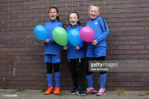 Fans pose for a photo ahead of the FA Women's Championship match between Millwall Lionesses and Manchester United Women at Princes Park on April 28...
