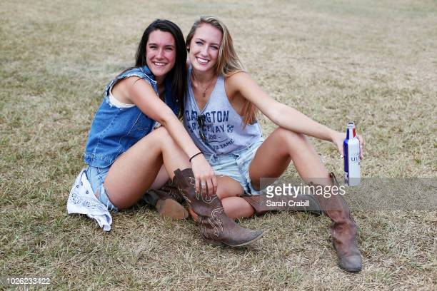 Fans pose for a photo at a tailgate party before the Monster Energy NASCAR Cup Series Bojangles' Southern 500 at Darlington Raceway on September 2...