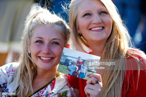 Fans pose for a photo before the Monster Energy NASCAR Cup Series Go Bowling 400 at Kansas Speedway on May 13 2017 in Kansas City Kansas