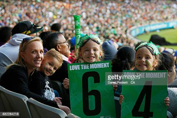 Fans pose for a photo during the Big Bash League match between the Melbourne Stars and the Adelaide Strikers at Melbourne Cricket Ground on January...