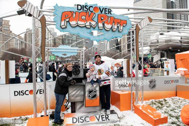 Fans pose for a photo during the Bridgestone NHL Winter Classic Park fan festival at Millenium Park on December 29 2018 in Chicago Illinois