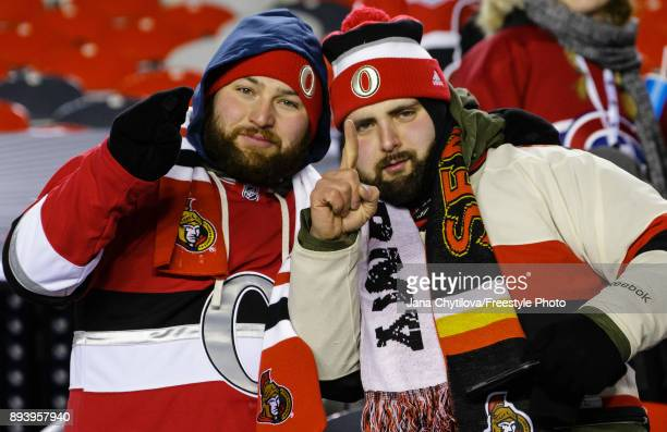 Fans pose for a photo following a game between the Ottawa Senators and the Montreal Canadiens during the of the 2017 Scotiabank NHL100 Classic at...