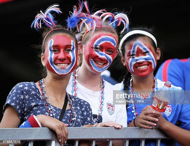 USA fans pose for a photo in before the Group D matches between Australia and Nigeria and USA and Sweden of the FIFA Women's World Cup 2015 at...
