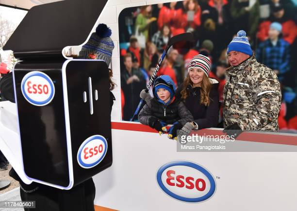 Fans pose for a photo in The PreGame in advance of the 2019 Tim Hortons NHL Heritage Classic as the Calgary Flames take on the Winnipeg Jets at...