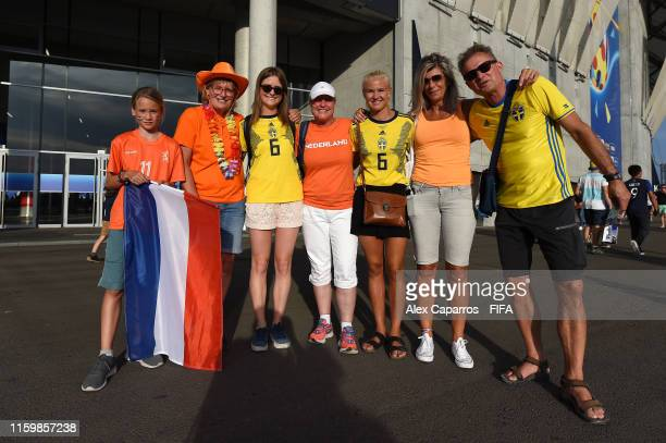 Fans pose for a photo outside the stadium prior to the 2019 FIFA Women's World Cup France Semi Final match between Netherlands and Sweden at Stade de...
