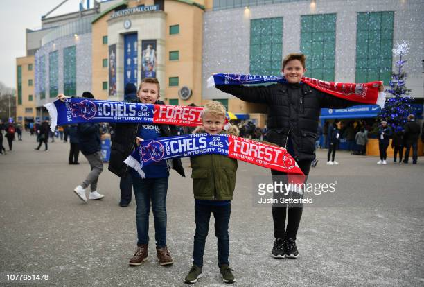 Fans pose for a photo outside the stadium prior to the FA Cup Third Round match between Chelsea and Nottingham Forest at Stamford Bridge on January 5...