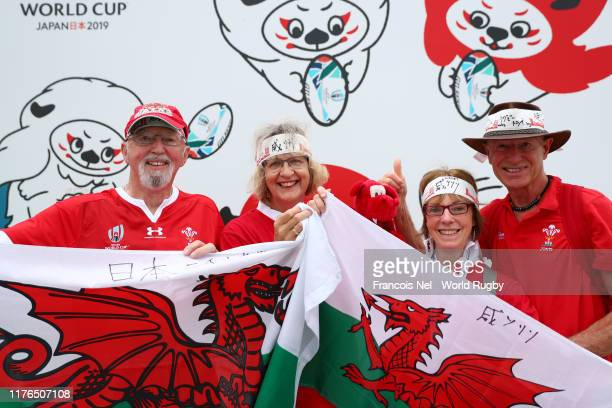 Fans pose for a photo outside the stadium prior to the Rugby World Cup 2019 Group D game between Wales and Georgia at City of Toyota Stadium on...