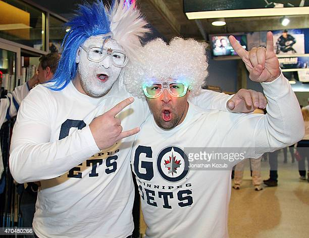 Fans pose for a photo prior to Game Three of the Western Conference Quarterfinals between the Winnipeg Jets and the Anaheim Ducks during the 2015 NHL...