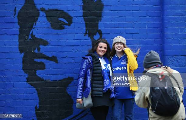 Fans pose for a photo prior to the Premier League match between Everton FC and AFC Bournemouth at Goodison Park on January 13 2019 in Liverpool...