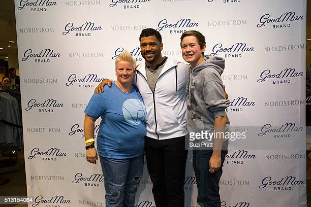 6bcef199994 Fans pose for a photo with Seattle Seahawks quarterback Russell Wilson at  Nordstrom on February 29