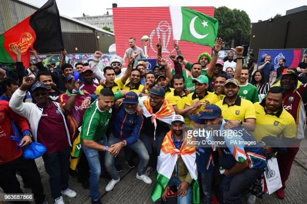 Fans pose for a photograph during the 2019 Cricket World Cup countdown event at 93 Feet East London
