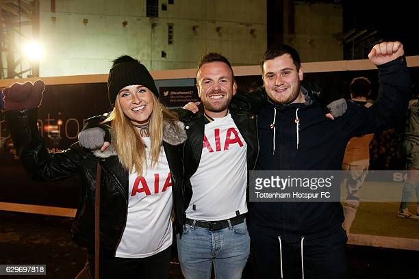 Fans pose for a photograph outside the stadium prior to the Premier League match between Tottenham Hotspur and Hull City at White Hart Lane on...