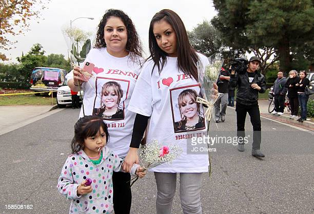 Fans pose for a photograph wearing a tshirt with the image of the late singer Jenni Rivera who died in a plane crash aged 43 early Sunday morning in...