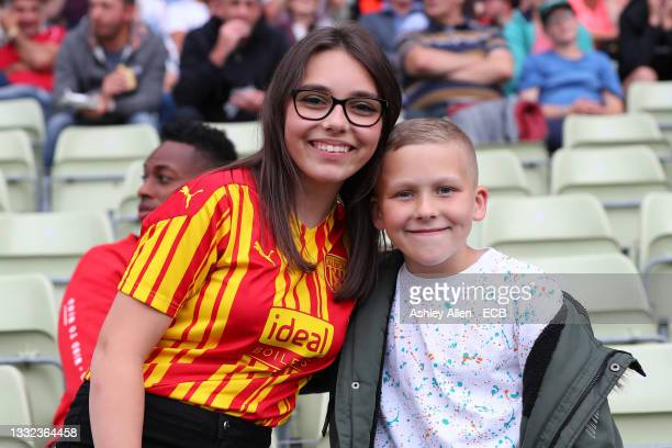 Fans pose for a picture during The Hundred match between Birmingham Phoenix Women and Oval Invincibles Women at Edgbaston on August 04, 2021 in...