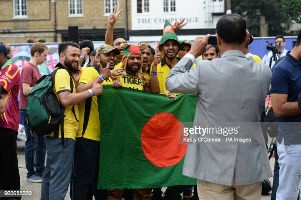 Fans pose for a selfie during the 2019 Cricket World Cup countdown event at 93 Feet East London