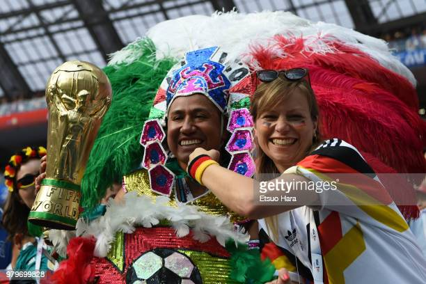 Fans pose for photographers prior to the 2018 FIFA World Cup Russia group F match between Germany and Mexico at Luzhniki Stadium on June 17 2018 in...