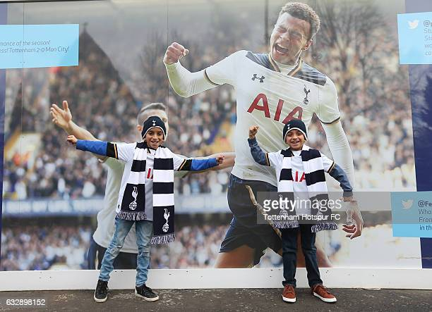 Fans pose for photographs prior to the Emirates FA Cup Fourth Round match between Tottenham Hotspur and Wycombe Wanderers at White Hart Lane on...