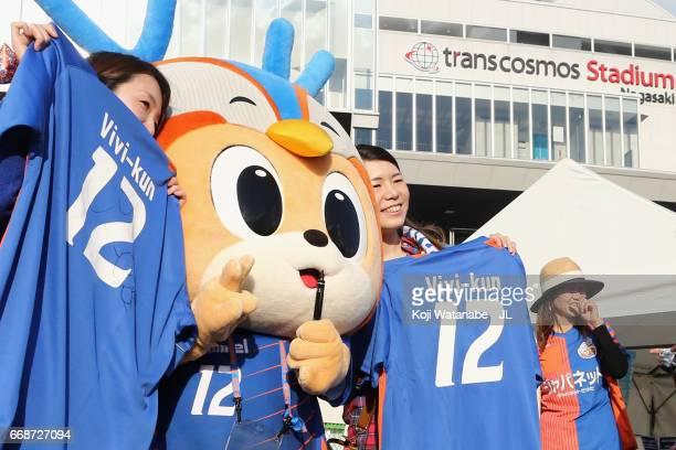 Fans pose for photographs with VVaren Nagasaki mascot Vivikun prior to the JLeague J2 match between VVaren Nagasaki and Avispa Fukuoka at transcosmos...