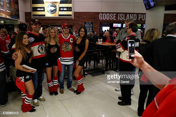 Fans pose for photos with members of the ice crew prior to Game Three of the 2015 NHL Stanley Cup Final between the Chicago Blackhawks and the Tampa...