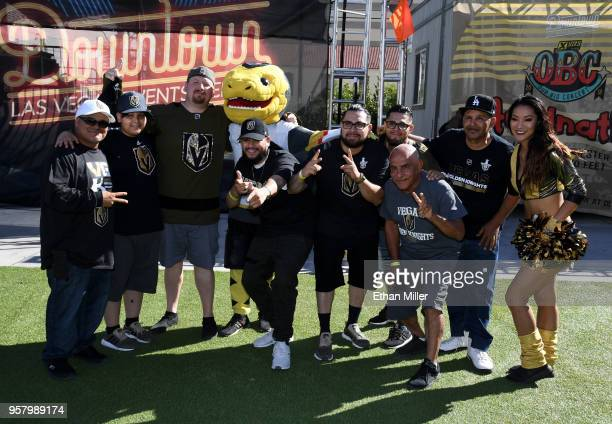 Fans pose for photos with the Vegas Golden Knights mascot Chance the Golden Gila Monster and a member of the Vegas Golden Knights Golden Aces during...