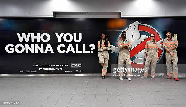 Fans pose in a commuter tunnel at Waterloo Station on July 11, 2016 in London, England. Ghostbusters take over Waterloo Station as Stay Puft...