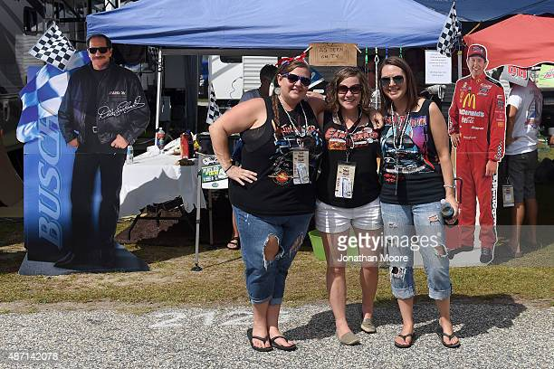 Fans pose in the infield campground while taking in festivities prior to the NASCAR Sprint Cup Series Bojangles' Southern 500 at Darlington Raceway...