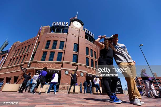 Fans pose outside the stadium ahead of a game between the Los Angeles Dodgers and Colorado Rockies on Opening Day at Coors Field on April 1, 2021 in...