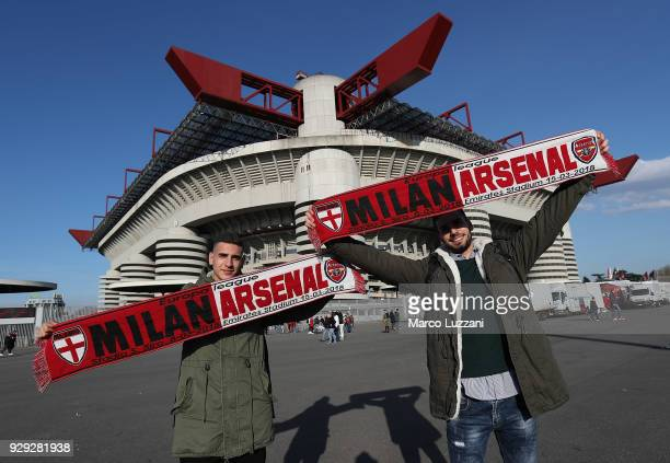Fans pose outside the stadium before UEFA Europa League Round of 16 match between AC Milan and Arsenal at the San Siro on March 8 2018 in Milan Italy