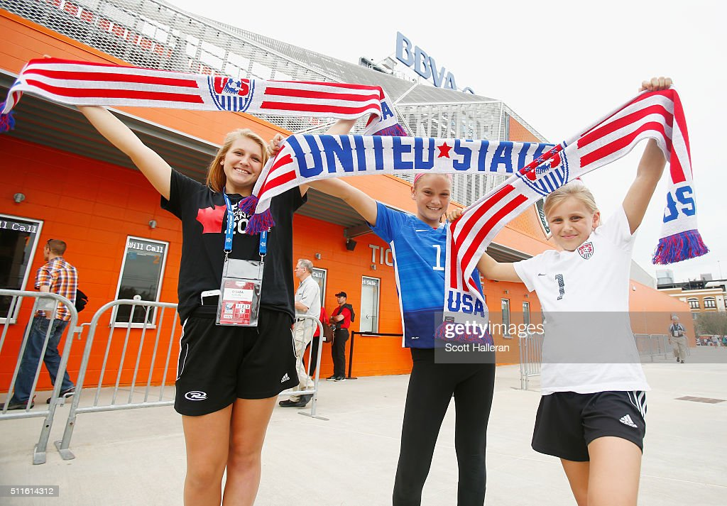 Fans pose outside the stadium prior to the game between the United States and Canada during the Championship final of the 2016 CONCACAF Women's Olympic Qualifying at BBVA Compass Stadium on February 21, 2016 in Houston, Texas.