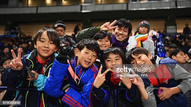Fans pose prior to the FIFA Club World Cup second round match between Mamelodi Sundowns and Kashima Antlers at Suita City Football Stadium on...